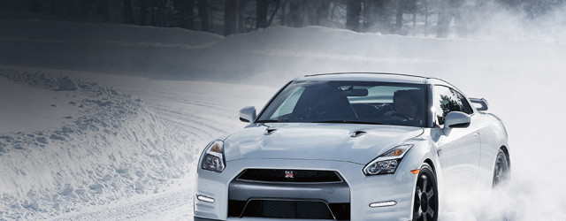 2016-nissan-gtr-black-edition-sports-car-driving-in-snow-pearl-white